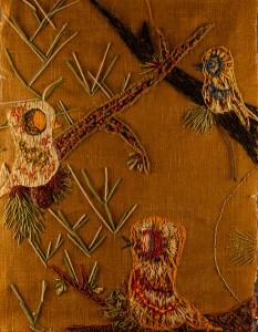 Yarn embroidery on burlap background