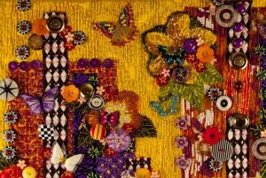 "Detail of contemporary, beaded art quilt ""Garden of Yellow and Butterflies"""