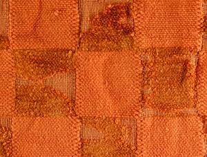 Close-up view of threadbare chenille bathmat