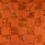 Section of an orange chenille bathmat