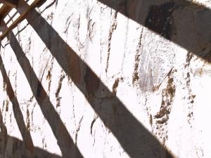 Stark shadows on a stone wall
